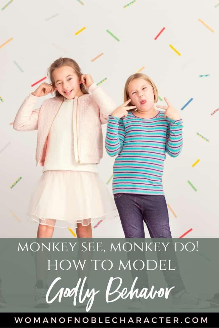 An image of two young girls standing against a colorful background and they are making funny faces with a text overlay that says Monkey See, Monkey Do_ How to Model Godly Behavior