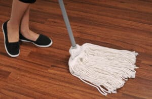 Mop for cleaning wooden floor from dust; she brings him good not harm