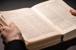 Person reading Bible; Christian friendship praying