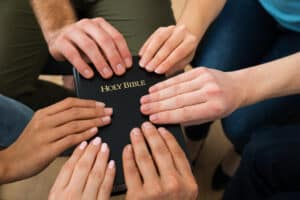People Holding Holy Bible, Christian friendship