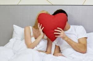 couple in bed with red heart; Proverbs 31:12