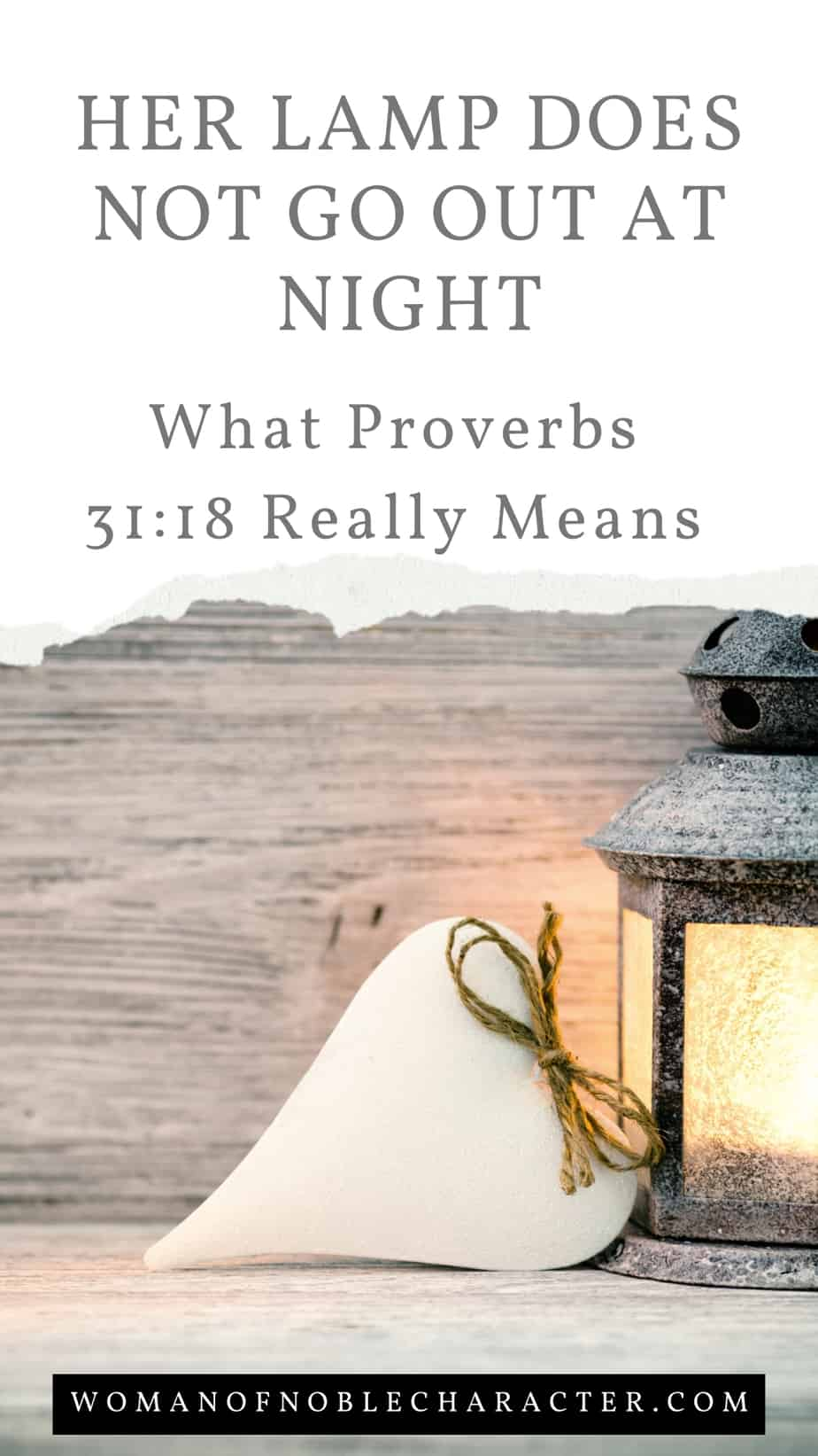 lantern with heart on wood background; Her Lamp Does Not Go Out At Night - What Proverbs 31:18 Really Means
