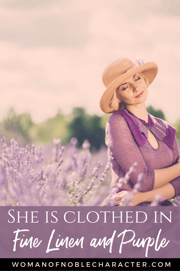 A woman in a field of purple flowers with a purple dress on - She is clothed in fine linen and purple