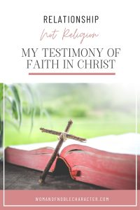 "An image of a cross lying on an open bible with the title, ""Relationship Not Religion: My Testimony of Faith in Christ"""