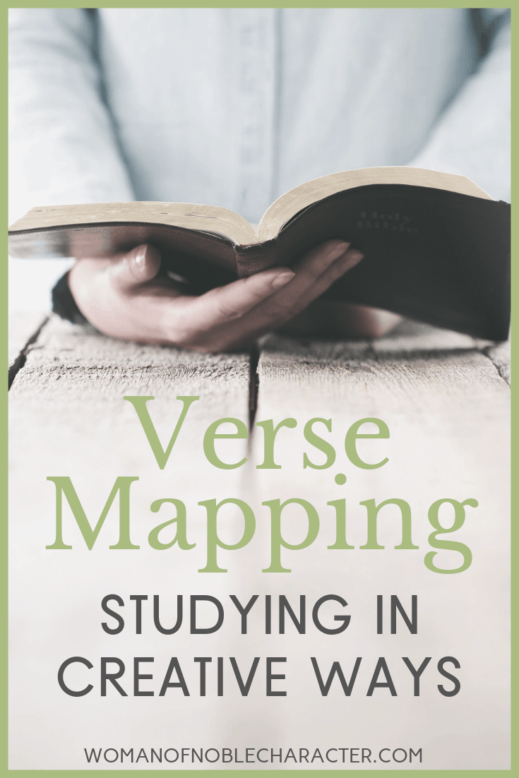 holding a bible at a table - verse mapping
