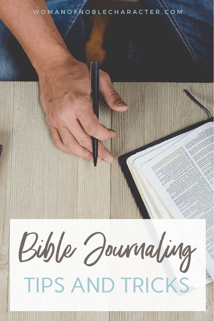 An image of someone holding a pen with a bible ontop of a table with an overlay of text saying,