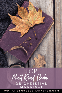 An image of a purple book on a wooden table with maple leafs on and around it and a gray sweater next to it - Books on Christian Marriage