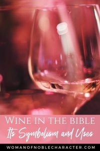 An image of a wine glass with a pink filter and text that says Wine in the Bible: Its Symbolism and Uses