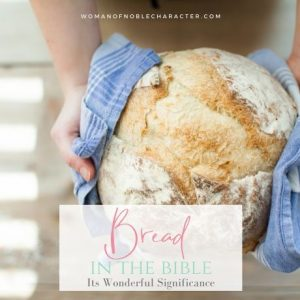 image of woman holding fresh baked bread with text overlay of symbolism of bread in the Bible;Bread in the Bible