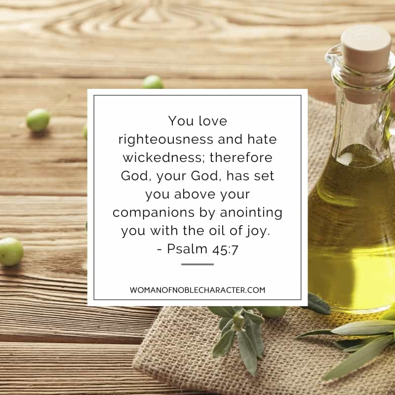An image of olives on a wooden table with a decanter of olive oil and Psalm 45:7 quoted