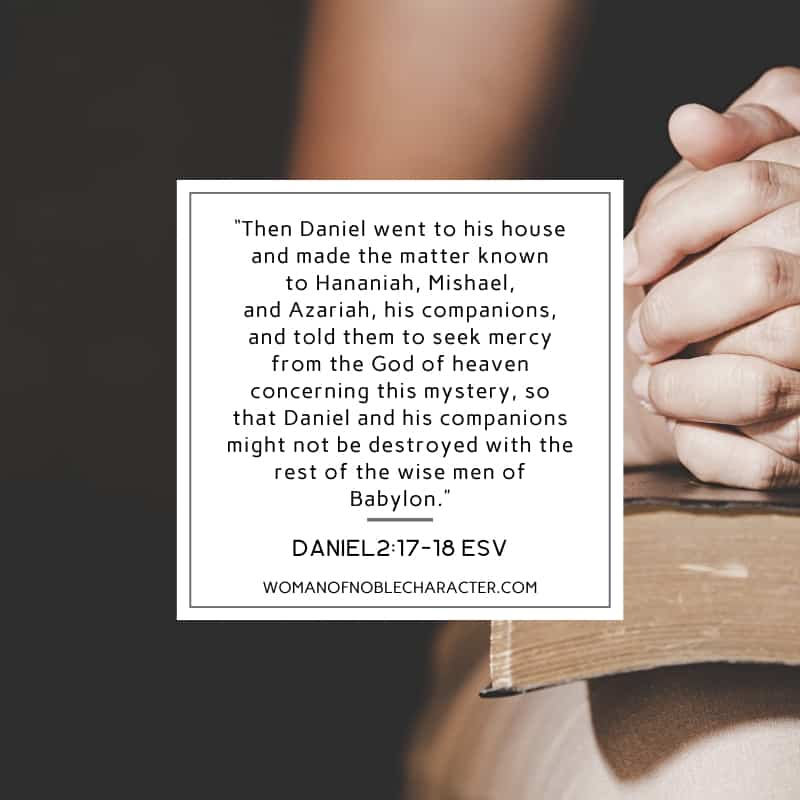 An image of a woman's hands folded in prayer on a Bible and Daniel 2:17-18 quoted from ESV