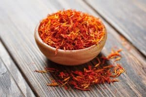 Saffron in wooden bowl, spices in the Bible and their uses