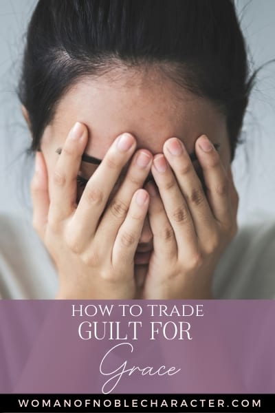 A woman with her dark hair pulled back in a ponytail and her head in her hands covering her eyes and a text overlay that says How To Trade Guilt For Grace