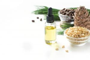 Cedarwood Oil, Cedar Oil in bottle and with branches