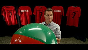 Church People movie lead actor Thor Ramsey holding a beachball