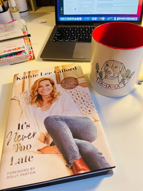 It's Never Too Late by Kathie Lee Gifford on desktop with computer and coffee cup