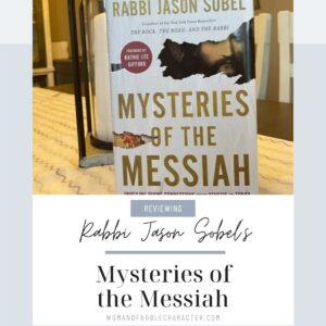 cover of Mysteries of the Messiah on table top with lantern