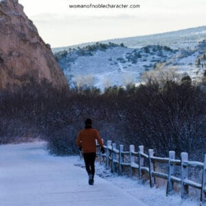 image of woman walking in rocky mountains for the post God is our Rock, a closer look