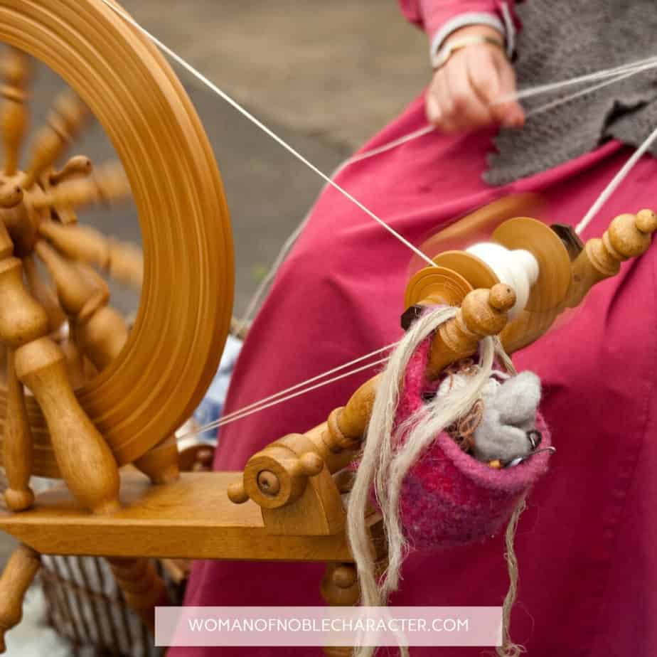 image of woman spinning yarn for the post Holding the Distaff? What Proverbs 31:19 Really Means in Modern Society