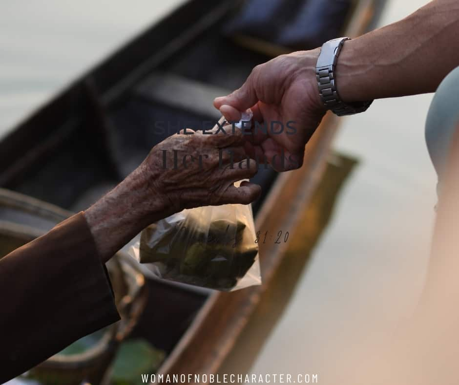 image of two hands reaching out and touching each other for the post She Extends Her Hands to the Needy: Living Out Proverbs 31:20