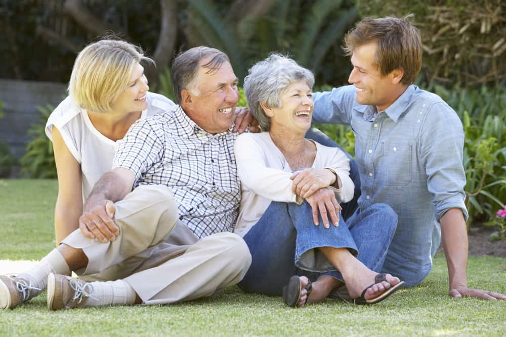 image of senior couple in garden with adult children for the post 10 Ways to Honor Your Parents as Adult Children
